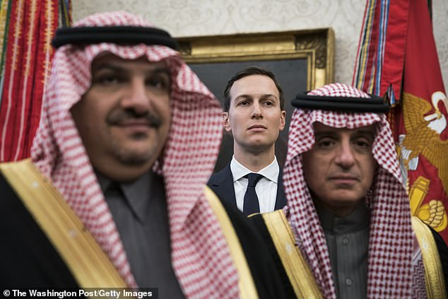 White House senior adviser Jared Kushner stands among Saudi officials as President Donald Trump talks with Crown Prince Mohammad bin Salman of the Kingdom of Saudi Arabia during a meeting in the Oval Office at the White House on Tuesday, March 20, 2018 in Washington, DC