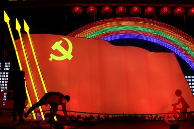 Men check on a light installation in a shape of the party flag of the Communist Party of China in Jining, Shandong province, China, 29 January 2019 (Photo: Reuters/Stringer)