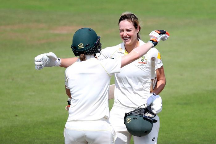 Ellyse Perry smiles as she huges Rachael Haynes to celebrate a century.