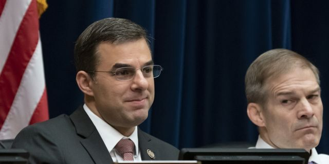 Rep. Justin Amash, R-Mich., left, joined at right Rep. Jim Jordan, R-Ohio, the ranking member, by votes with Democrats on the House Oversight and Reform Committee to subpoena presidential counselor Kellyanne Conway for not appearing before the panel after allegations that she repeatedly violated the Hatch Act. (AP Photo/J. Scott Applewhite)