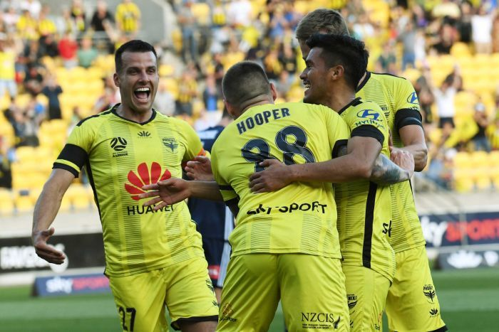 The Wellington Phoenix celebrate a goal against Melbourne Victory in the A-League.