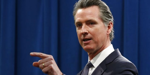 California Gov. Gavin Newsom speaks to reporters during a news conference in Sacramento, Calif., Thursday, March 12, 2020.