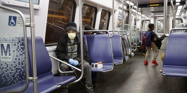 Andre of Washington, D.C., rides the Metro subway Green Line train in Washington, Friday, March, 13, 2020.