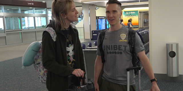Jack Howarth (right) and his wife, Lucy, arrive at Orlando International Airport for their two-year wedding anniversary (Robert Sherman, Fox News)
