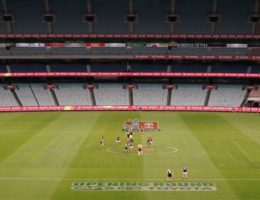 'It is like a ghost town': AFL, NRL enter the brave new world of no crowds at matches