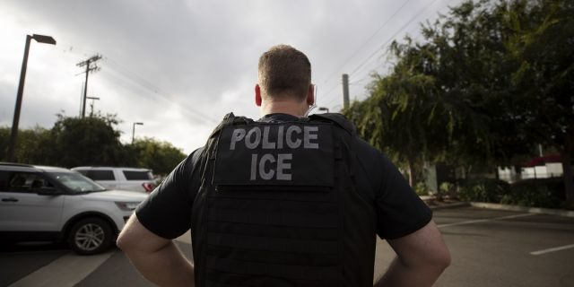 A U.S. Immigration and Customs Enforcement (ICE) officer looks on during an operation in Escondido, Calif. (Associated Press)