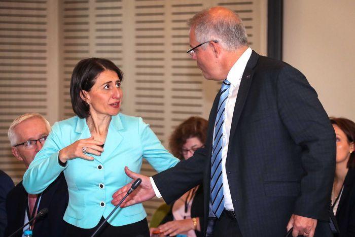 Scott reaches to shake Gladys Berejiklian's hand