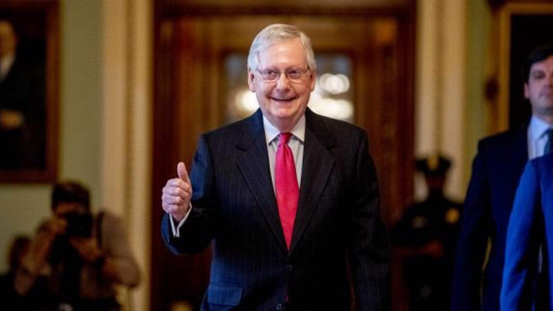 Senate Majority Leader Mitch McConnell of Ky. gives a thumbs up as he leaves the Senate chamber on Capitol Hill in Washington. (AP Photo/Andrew Harnik)