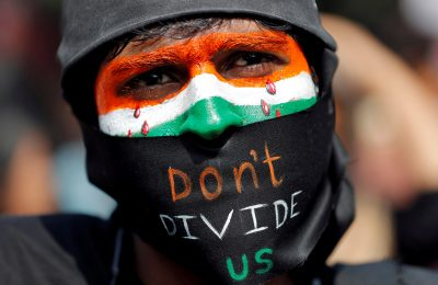 A demonstrator attends a protest against riots following clashes between people demonstrating for and against a new citizenship law in New Delhi, India, 3 March 2020 (Photo: Reuters/Adnan Abidi).