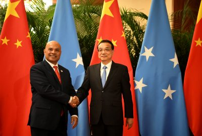 China's Premier Li Keqiang shakes hands with Micronesia's President David Panuelo at the Great Hall of the People in Beijing, China, 13 December 2019 (Photo: Noel Celis/Pool via Reuters).