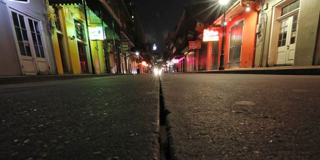 Anearly deserted scene on Bourbon Street, which is normally bustling with tourists and revelers, in the French Quarter of New Orleans, March 19, 2020. (Associated Press)