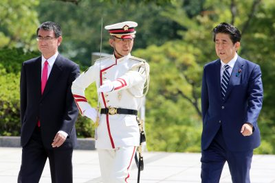 Japanese Prime Minister Shinzo Abe (R), accompanied by Defense Minister Taro Kono (L), reviews honor guards at Defense Ministry in Tokyo on Tuesday, 17 September 2019. (Photo by Yoshio Tsunoda/AFLO via Reuters).