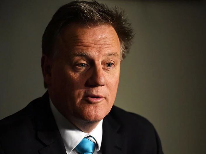 Port Adelaide CEO Keith Thomas wearing a suit