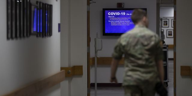 A member of the U.S. Army walks down a hall at Fort Meade, Md., back in March.