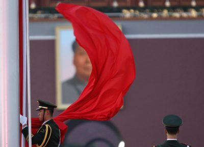 A paramilitary policeman holds the Chinese national flag at a flag lowering ceremony on Tiananmen square next to the Great Hall of the People (Photo: REUTERS/Kim Kyung-Hoon).