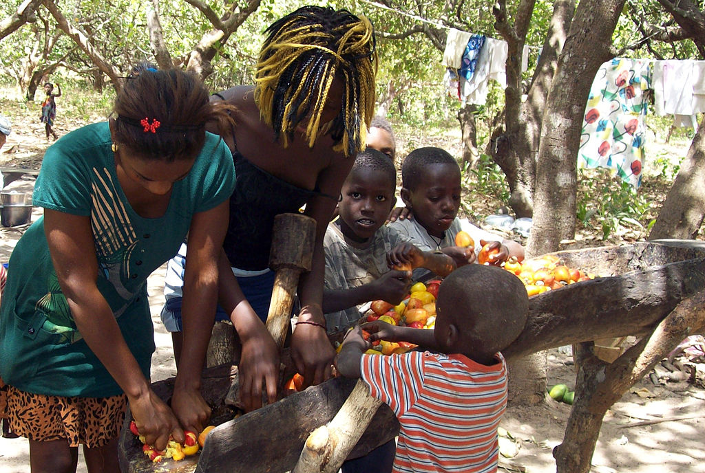Children sorting out tomatoes