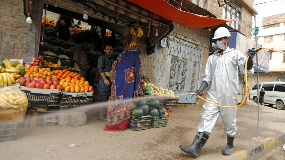 A health worker wearing a protecitve suit disinfects a market amid concerns of the spread of the coronavirus disease (COVID-19), in Sanaa