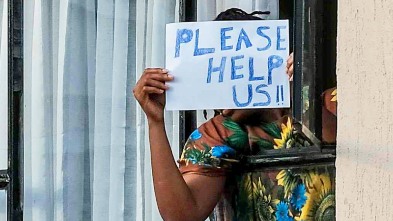 "Someone in quarantine in Kenya holding up a ""Please help us"" sign - April 2020"