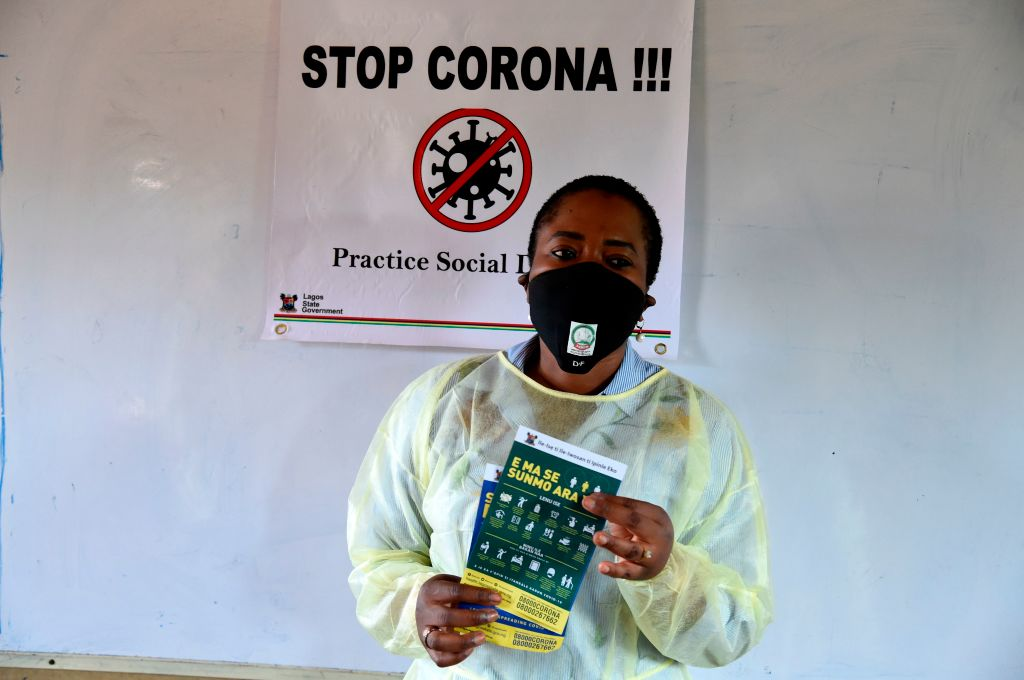 Woman holding coronavirus message pamphlet