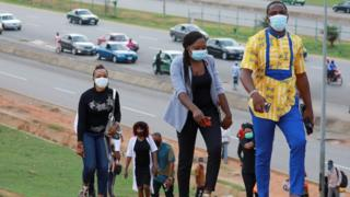 People go to work as authorities ease the lockdown following the coronavirus disease (COVID-19) outbreak in Abuja, Nigeria May 4, 2020