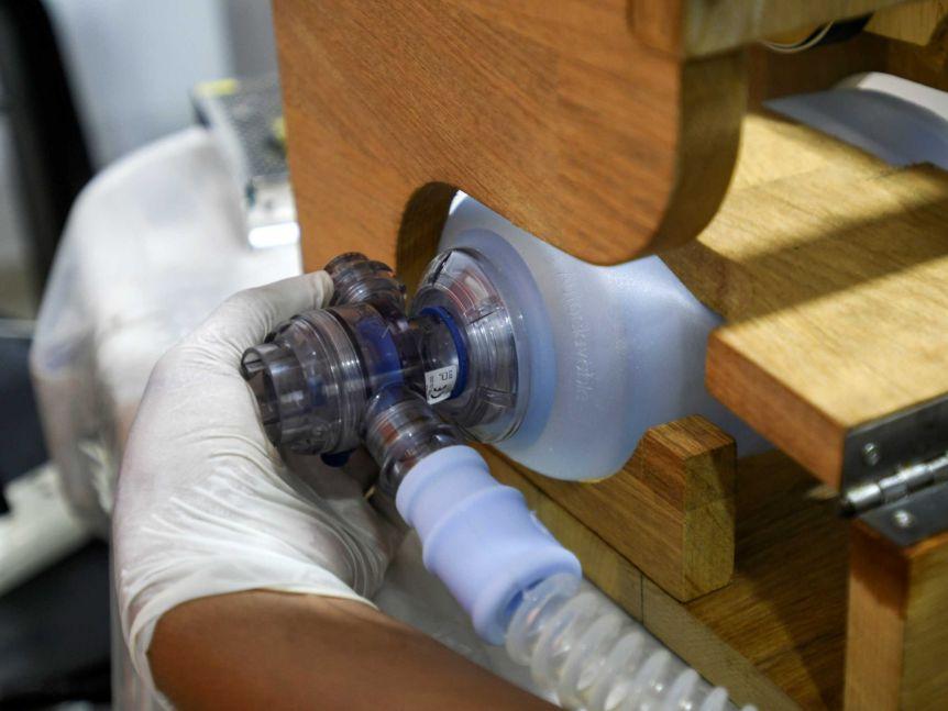 A volunteer works on a ventilator for use during the coronavirus disease (COVID-19) outbreak, in Santa Cruz, Bolivia.