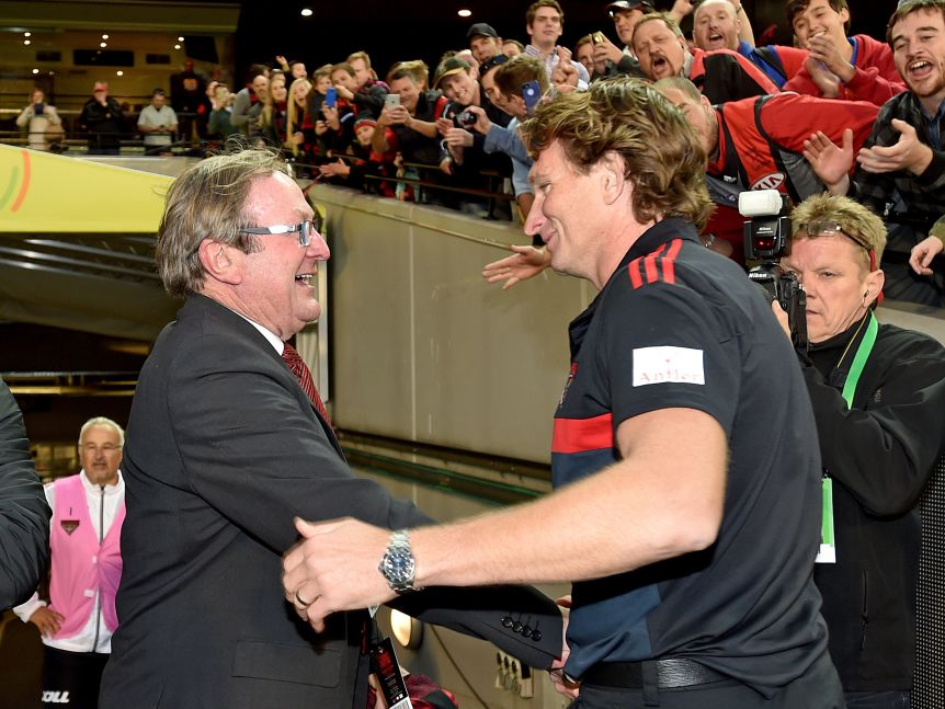 Kevin Sheedy shakes hands with James Hird