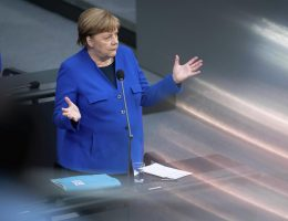 Merkel urges virus vigilance; Germany loosens border checks