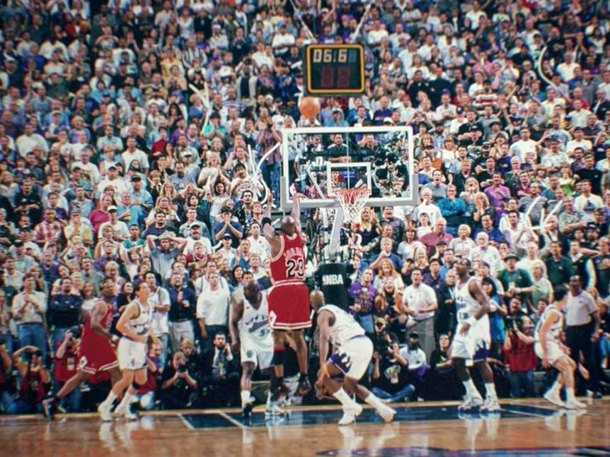 Michael Jordan shoots a game-winning shot in game six of the 1998 NBA Finals against the Utah Jazz.