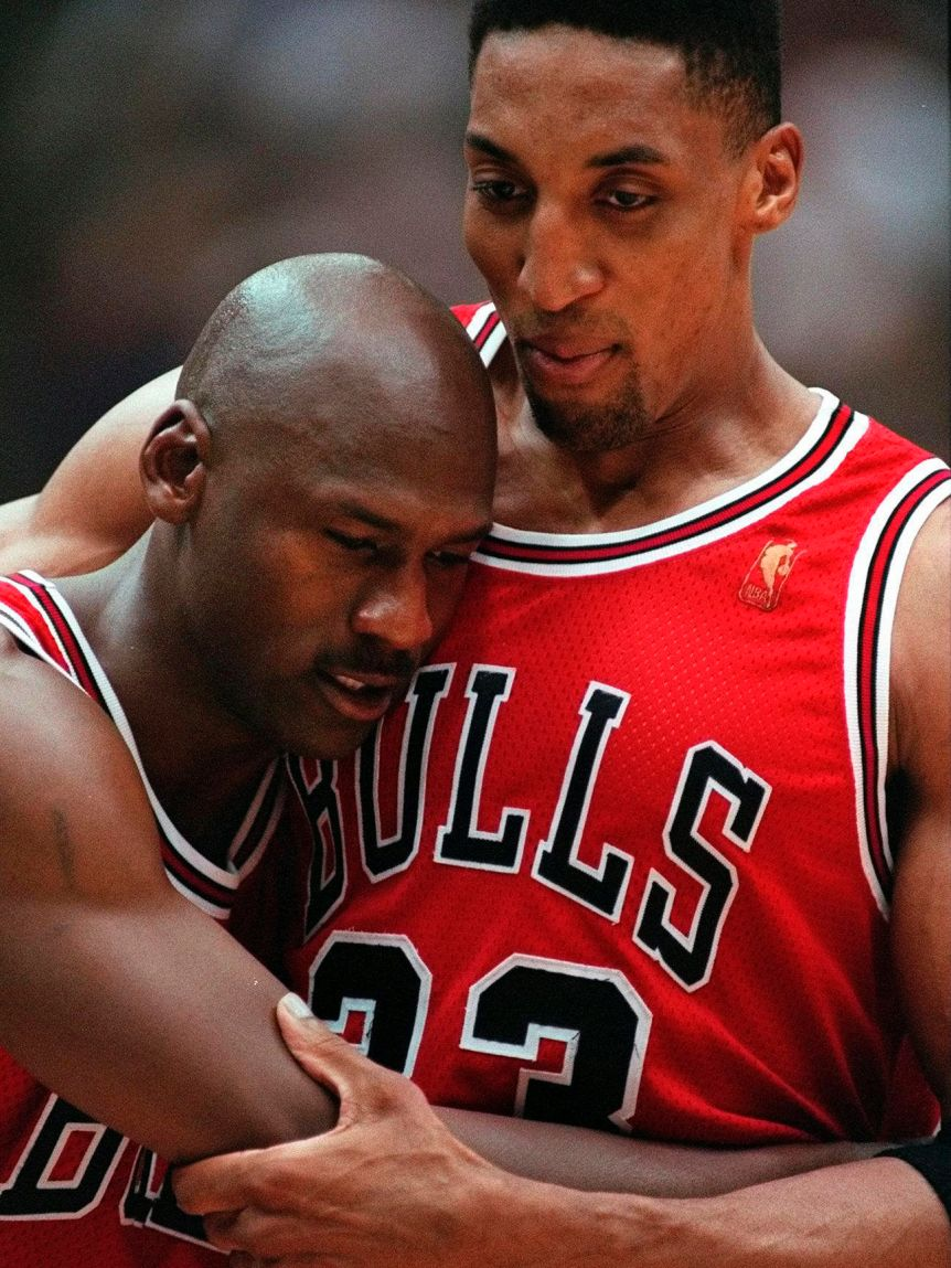 Scottie Pippen holds up Michael Jordan during game five of the 1997 NBA Finals between the Chicago Bulls and Utah Jazz.