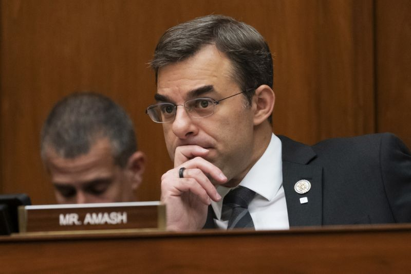 FILE - In this June 12, 2019, file photo, Rep. Justin Amash, R-Mich., listens to debate on Capitol Hill in Washington. Amash, a Trump critic, said Saturday, May 16, 2020, that he has decided not to seek the Libertarian nomination to run for president. (AP Photo/J. Scott Applewhite, File)