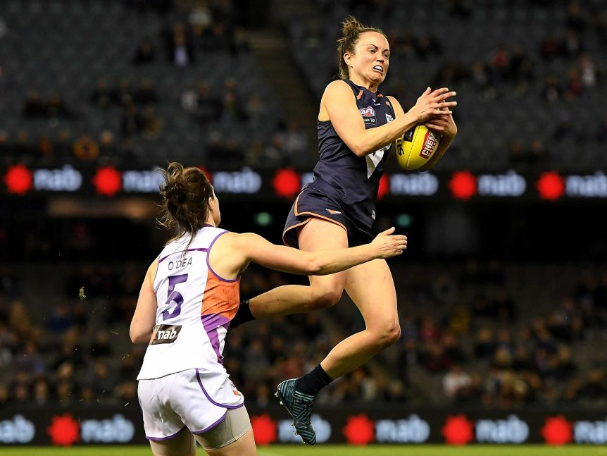 Daisy Pearce takes a mark for Victoria against the Allies