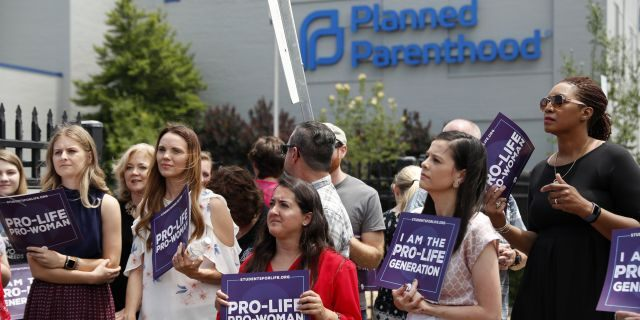 FILE - In this June 4, 2019, file photo, anti-abortion advocates gather outside the Planned Parenthood clinic in St. Louis. (AP Photo/Jeff Roberson, File)