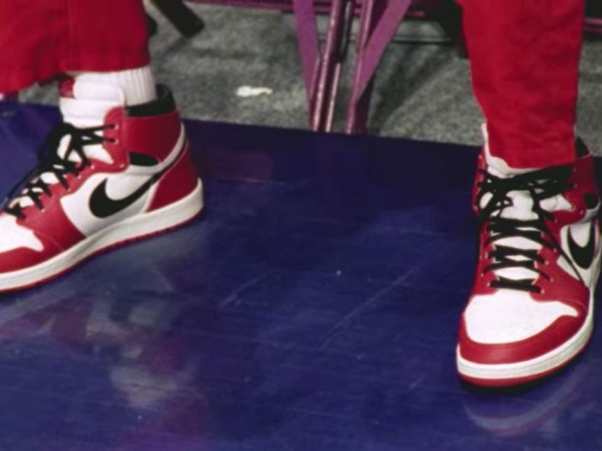 Michael Jordan's feet in a pair of red, black and white Air Jordan 1s before a game in 1998.