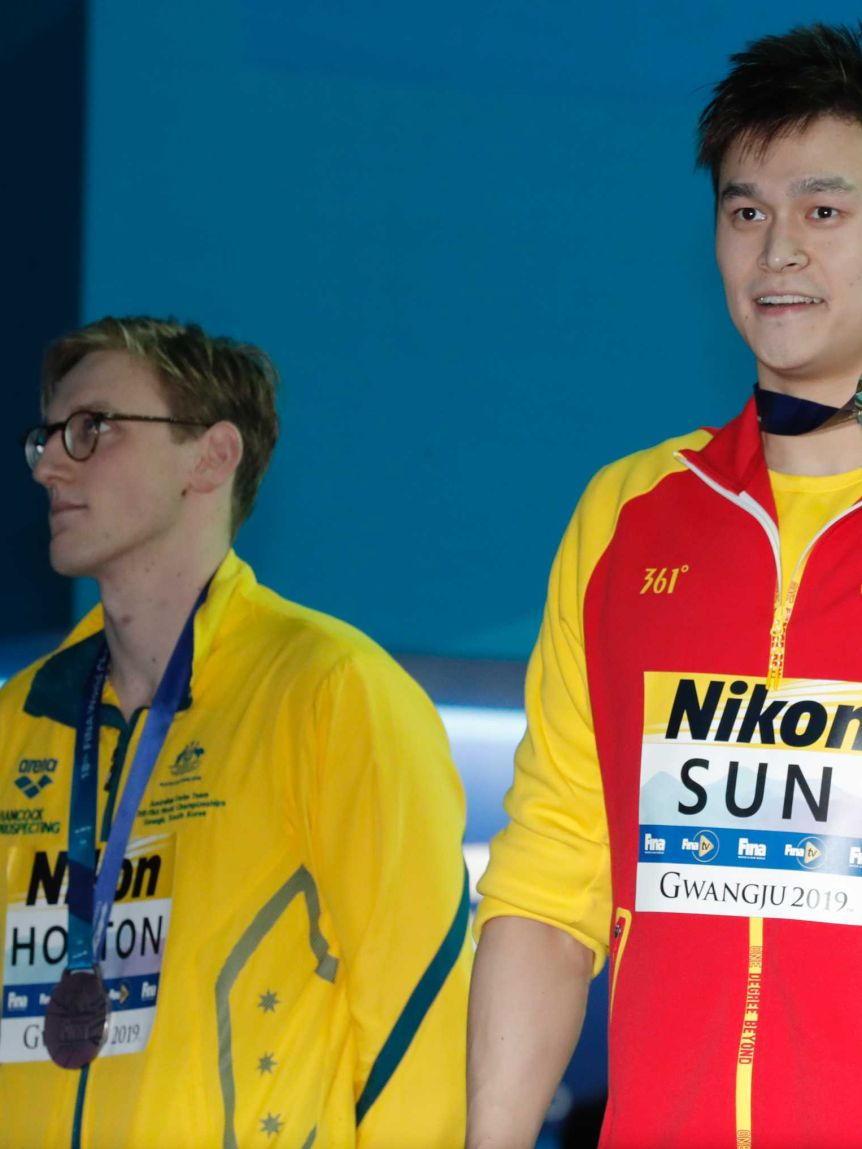 Australian swimmer Mack Horton (left) looks elsewhere while Sun Yang and Gabriele Detti hold up their world championship medals.