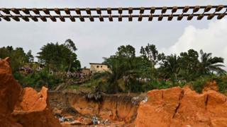 A suspended railway track at the site of a landslide that killed 13 people the day before, in Anyama, near Abidjan - 19 June 2020