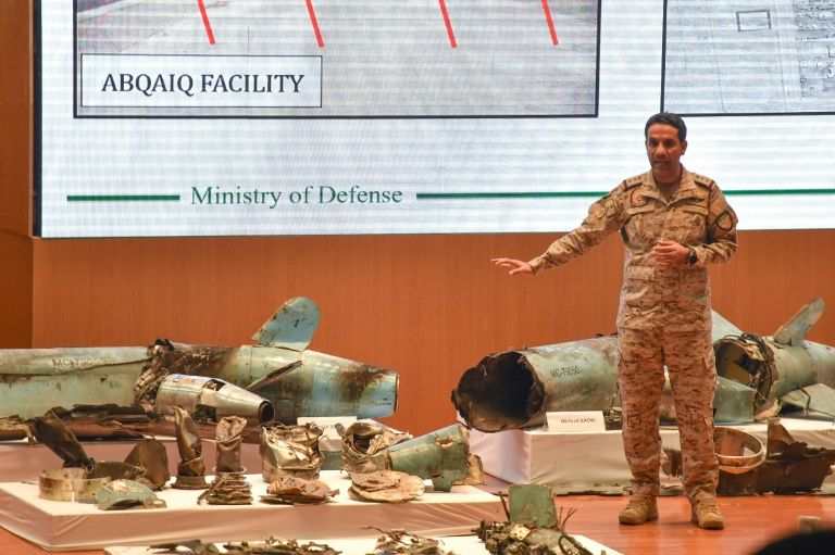"""A Saudi defence ministry spokesman displaying pieces of what he said were Iranian cruise missiles and drones recovered from the attack site that targeted Saudi Aramco's facilities in 2019. A UN report confirmed the weapons were """"of Iranian origin"""""""