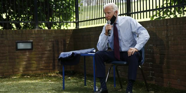 Democratic presidential candidate, former Vice President Joe Biden speaks with families who have benefited from the Affordable Care Act, Thursday, June 25, 2020, in Lancaster, Pa. (Associated Press)