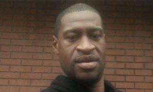 Man, 26, charged over 'George Floyd death' image