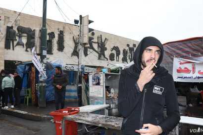 Ali Almikdam attends a protest in Baghdad, Jan. 22, 2020. (Heather Murdock/VOA)