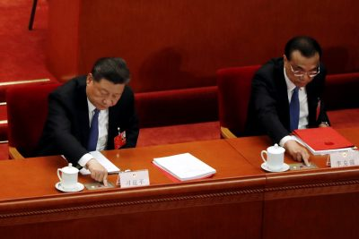 Chinese President Xi Jinping and Premier Li Keqiang cast their votes on the national security legislation for Hong Kong Special Administrative Region at the closing session of the National People's Congress (NPC) at the Great Hall of the People in Beijing, China, 28 May 2020 (Photo: REUTERS/Carlos Garcia Rawlins).