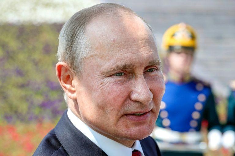 The coronavirus pandemic had exposed 'deep-seated internal crises' in the US, said Putin (AFP Photo/Mikhail Klimentyev)