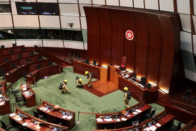 Firefighters wearing gas masks check the chamber of the Legislative Council in Hong Kong, China, 28 May 2020 (Photo: REUTERS/Jessie Pang).