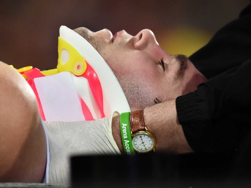 St Kilda's Paddy McCartin is stretchered off after a head clash against Adelaide