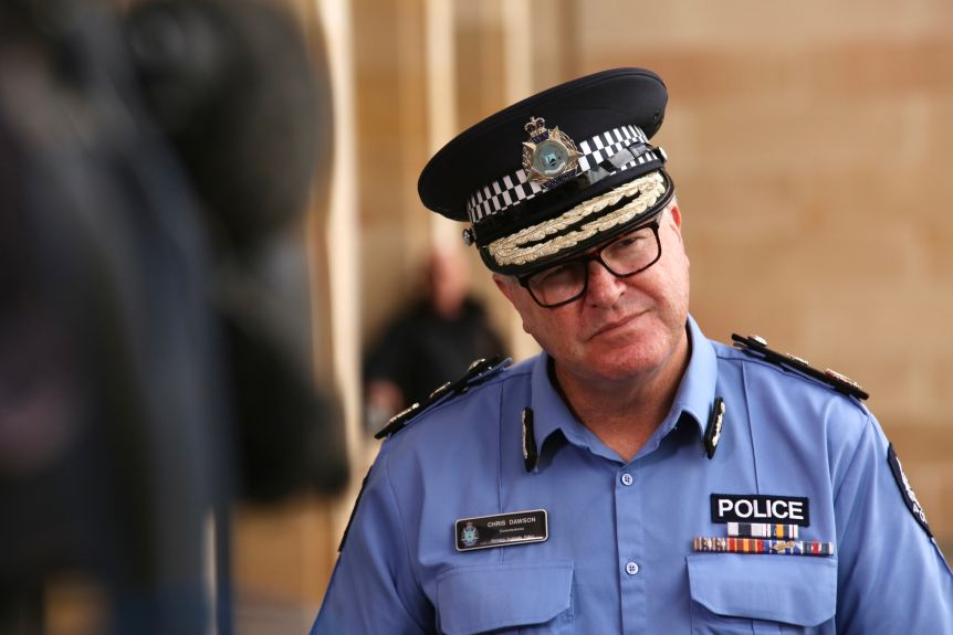 The WA Police Commissioner Chris Dawson, in uniform and hat, speaks at a media conference in Perth