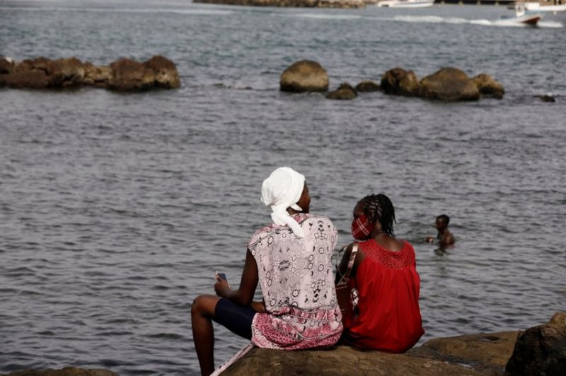 "Women sit on a rock at a beach called ""Plongeoir"", amid the outbreak of the coronavirus disease (COVID-19) in Dakar, Senegal June 28, 2020."