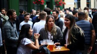 Drinkers at a pub in Borough Market