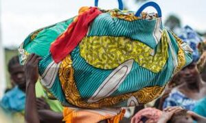 Coronavirus: Uganda opens border to stranded refugees