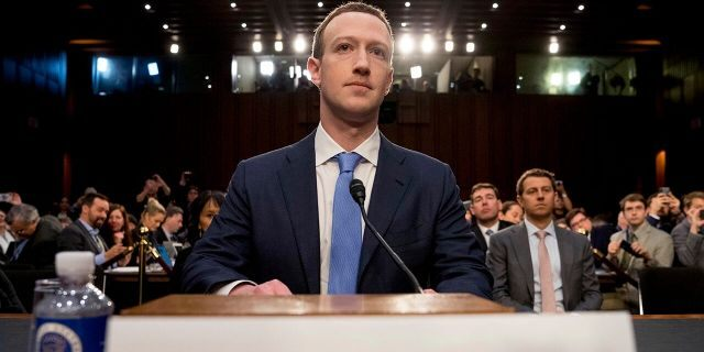 In this April 10, 2018 photo, Facebook CEO Mark Zuckerberg arrives to testify before a joint hearing of the Commerce and Judiciary Committees on Capitol Hill in Washington. (AP Photo/Andrew Harnik)