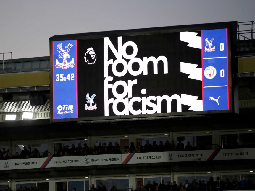 An anti-racism message is displayed on the big screen at the ground during a Premier League match.