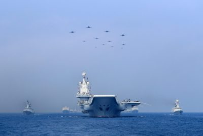 Warships and fighter jets of the Chinese People's Liberation Army (PLA) Navy take part in a military display in the South China Sea, 12 April 2018 (Photo: China Stringer Network via Reuters).